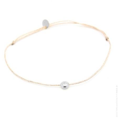 Silver round on a lurex Bracelet