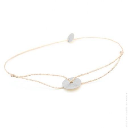 Silver circle on a lurex Bracelet