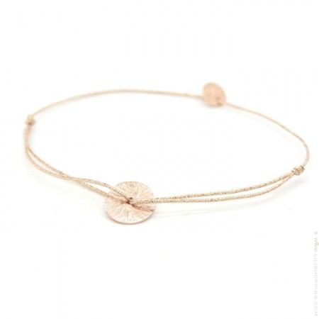 Pink gold platted circle on a lurex Bracelet