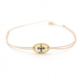 Gold plated bangle with blue saphir stones cross