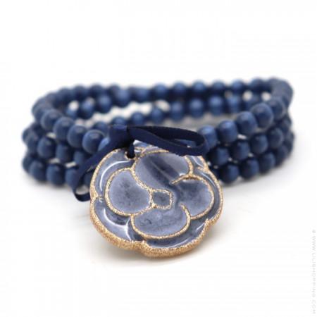 Bracelet / collier camélia bleu nacré doré