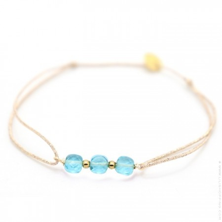 3 topaze stones on a lurex Bracelet