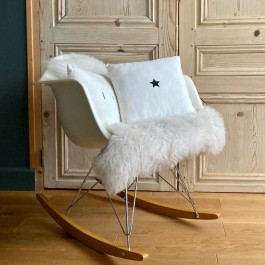 Square old white linen cushion with a black star