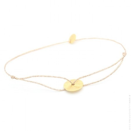 Gold platted circle on a lurex Bracelet
