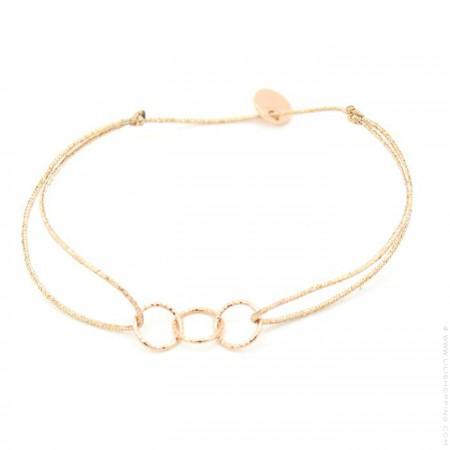 3 Pink gold platted hammered rings on a lurex Bracelet