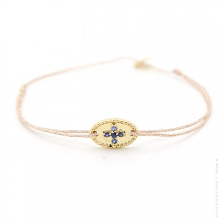 Gold plated bracelet with blue saphir stones cross