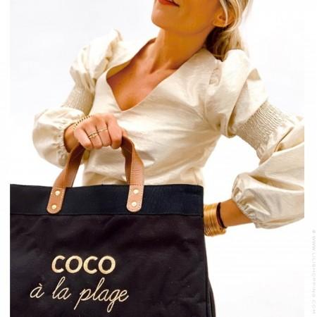 Sac cabas Le Mademoiselle Black Coco à la plage gold