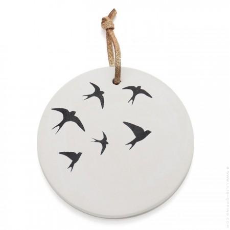 Black swallows medaillon