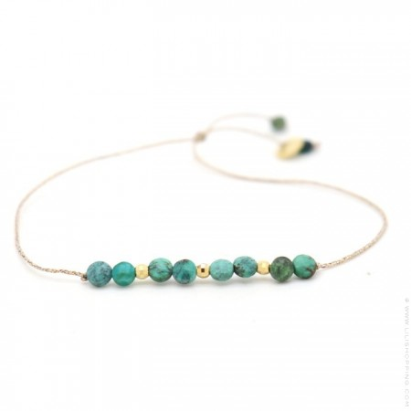 Turquoises and gold plated nuggets on a lurex Bracelet