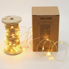 Galaxy led garland on vintage wooden coil