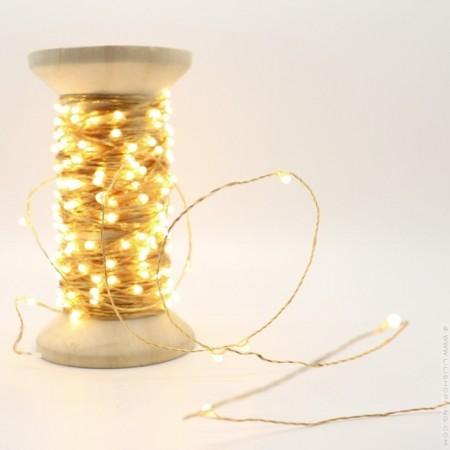 Univers led garland on vintage wooden coil
